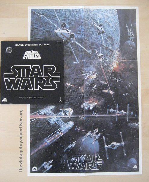 The poster artwork was by John Berkey. Look closely and you'll see more than one YT-1300 space vehicle. What's a YT-1300? Clue: Han and Chewie flew a heavily-modified version :)