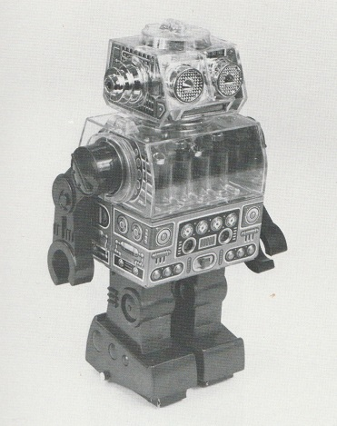 PISTON ROBOT, battery operated plastic and tinplate robot, by Horikawa, Japan, 1960s. From Christie's South Kensington auction catalogue. 1988.