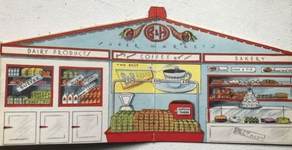 Cardboard cutout of fictional Supermarket showing Coffee, Bakery and Dairy Products displays.