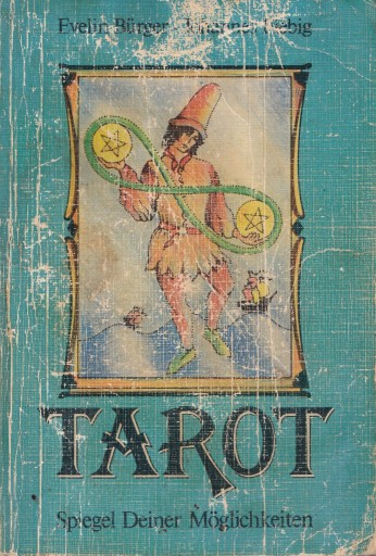 photo of cover of a book on interpreting Tarot cards - showing the 2 of pentacles of the Raider-Waite deck